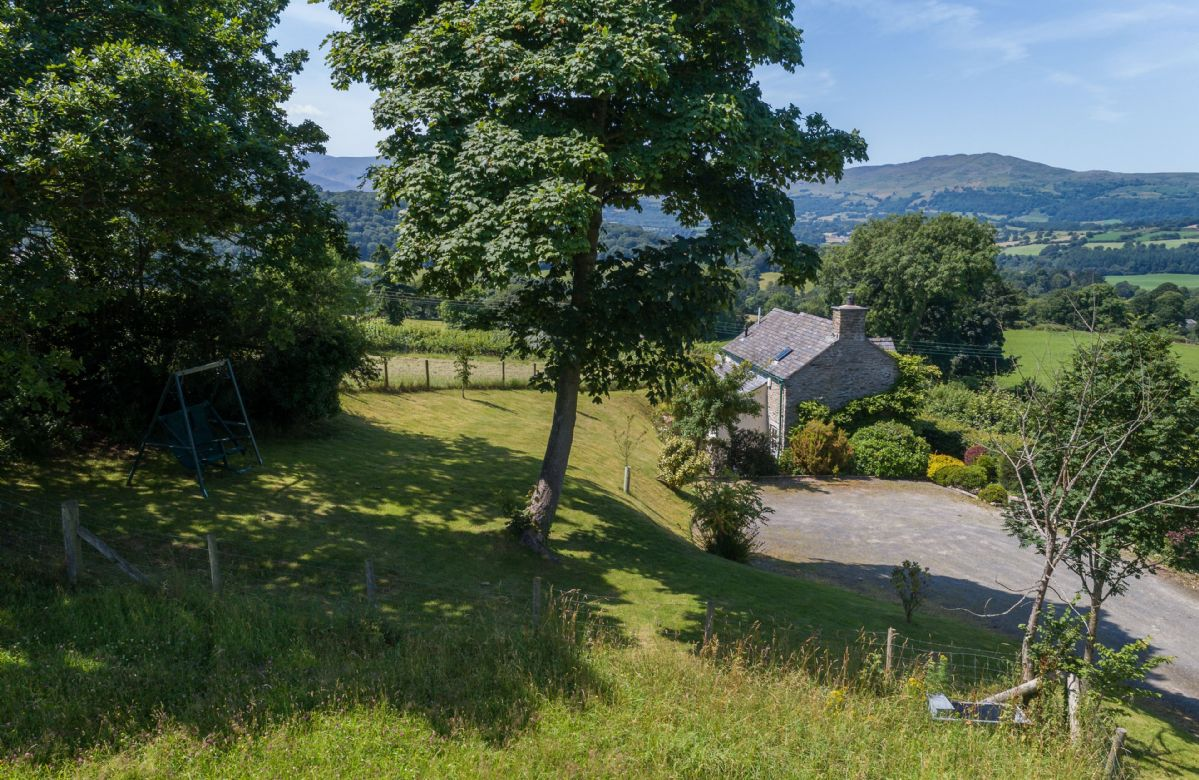 Ty Ucha'r Ffordd a holiday cottage rental for 2 in Bodnant Estate,
