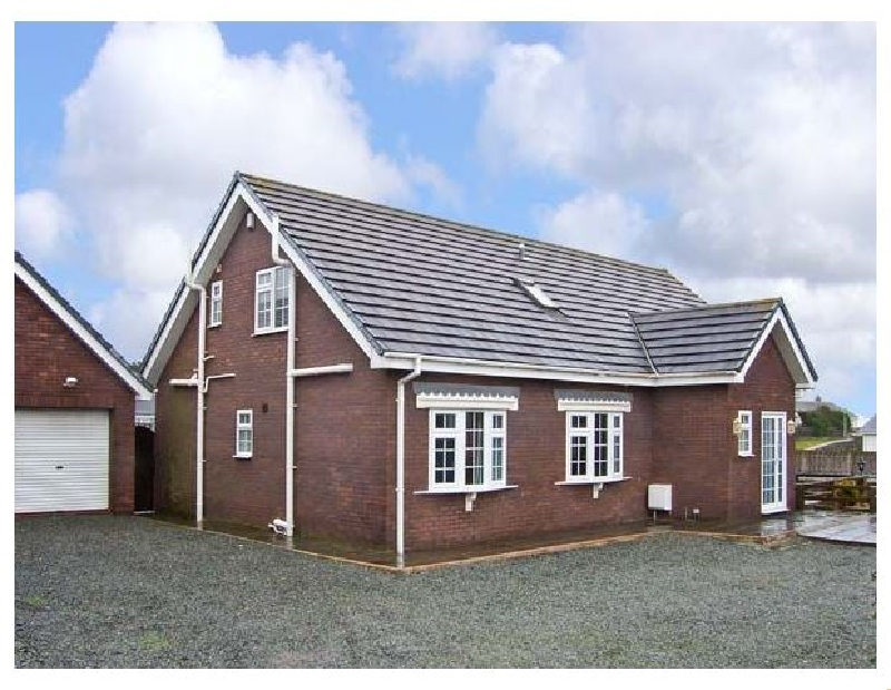 Firhaven a holiday cottage rental for 12 in Rhosneigr,