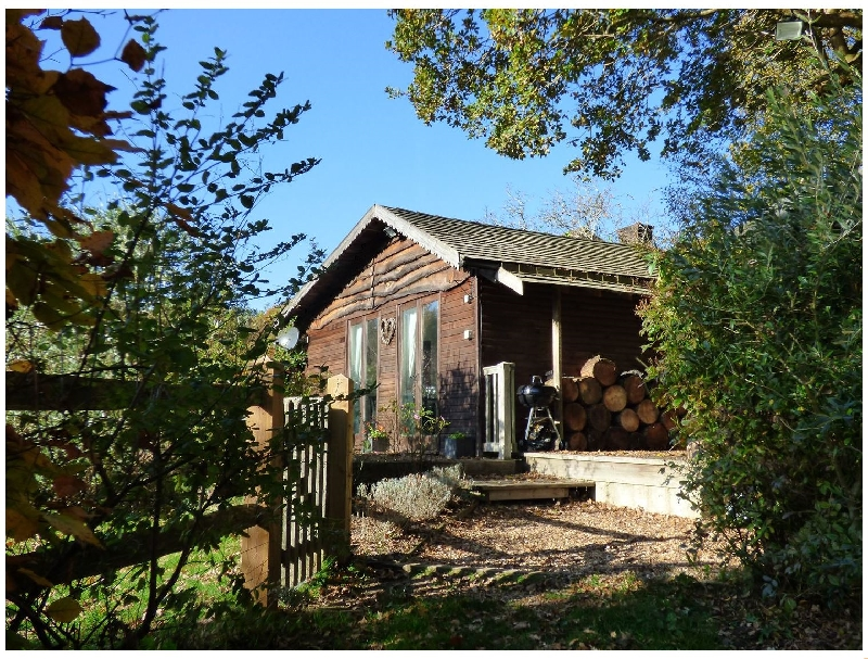 Woodmancote Lodge a holiday cottage rental for 3 in Linchmere ,